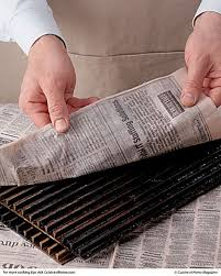 newspaper cleaning barbeque grill